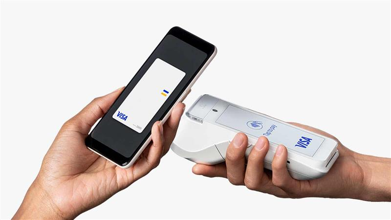 R2-D2 Charging Hub attached to mobile phone in car console.