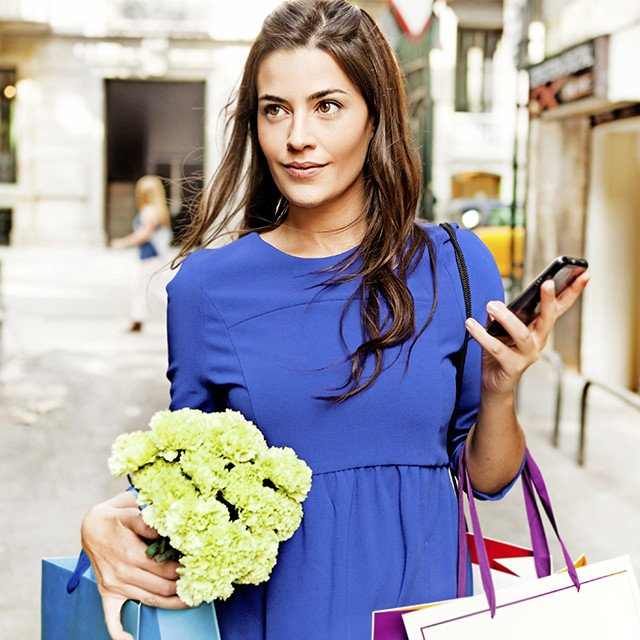 Woman shopping and holding a phone