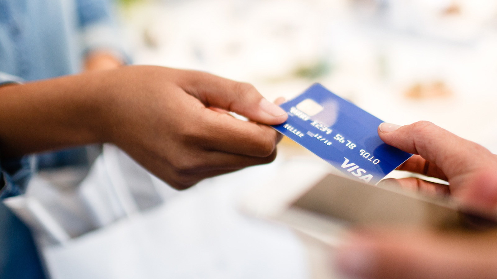 Woman passing debit card